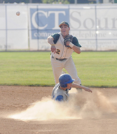 Lynn: North Reading's 2nd baseman Matthew Barretto turns a double play during the Hornet's's 2-1 loss to Georgetown at Fraser Field in Lynn. Jim Vaiknoras/staff photo