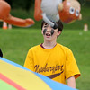 "Newburyport: Dan Baribeault participates in ""Jungle Gone Wild"", an event were kids toss plastic animals off a parachute ,during Survival Day at the Molin School Thursday. 4th and 5th graders emulated the TV show Survivor with 14 events testing the students skills and resolve. Jim Vaiknoras/staff photo"