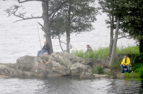 Amesbury: A trio of fisherman try their luck off Deer Island  in Amesbury on a rainy Sunday morning. Jim Vaiknoras/staff photo