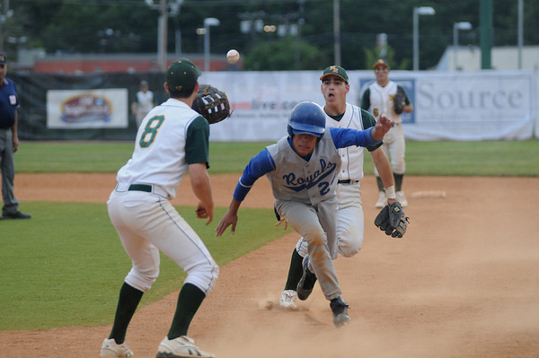 Lynn: Georgetown's Danyer Fabian escapes a rundown between North Reading's first baseman jeffrey Cady and 2nd baseman Matthew Barretto during the Royal's 2-1 victory at Fraser Field in Lynn. Jim Vaiknoras/staff photo