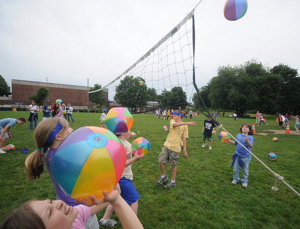 Newburyport: 4th graders play extreme beach vollyball during Survival Day at the Molin School Thursday. 4th and 5th graders emulated the TV show Survivor with 14 events testing the students skills and resolve. Jim Vaiknoras/staff photo