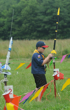 Newbury: Zachary Singer, 8, of Den 6, prepares his rocket for flight at the Rocket Launch at the Spencer-Pierce Little Farm in Newbury Saturday. Jim Vaiknoras/Staff photo