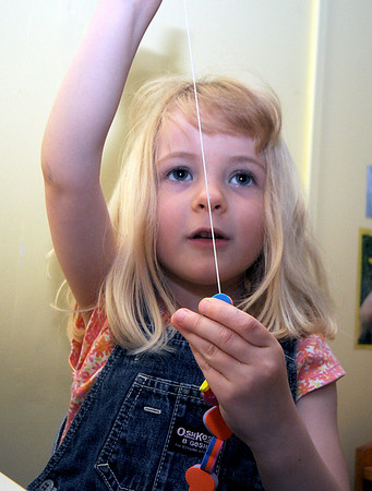 "Newburyport: Charlotte "" Cricket"" Larson ,4, makes a neckless out of hearts at the summer school program at the Montessori School in Newburyport. Jim Vaiknoras/Staff photo"