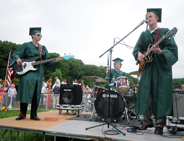"West Newbury: Matthew Robert Pendergast on guitar, Keith P.Mosley on bass and Douglas ""Doogie"" Mead on drums rock the school song ""Alma Mater"" at the Pentucket Graduation Saturday morning.Jim Vaiknoras/staff photo"
