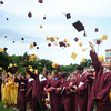 Newburyport. Newburyport graduating seniors toss their caps Sunday at World War Memorial Stadium. Jim Vaiknoras/staff photo
