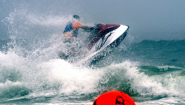 Salsibury: On of the participants hits a wave during the SeaDoo races at the Sand and Sea Festival on Salisbury Beach Saturday. Jim Vaiknoras/Staff photo