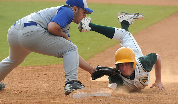Lynn: Georgetown's Marco Luisi is  a little late with the tag as North Reading's Eric Vacca dives back to first during the Royal's 2-1 victory at Fraser Field in Lynn. Jim Vaiknoras/staff photo
