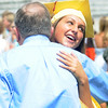 Newburyport: Jillian Kinter  hugs her grandfather Richard Kinter after the Newburyport graduation Sunday at World War Memorial Stadium.Jim Vaiknoras/staff photo