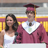 Newburyport: Newburyport high senior class president Nicholas Osborne presents the class gift to junior class president Alexandra Loring at the graduation ceremony Sunday afternoon at World War Memorial Stadium.Jim Vaiknoras/staff photo