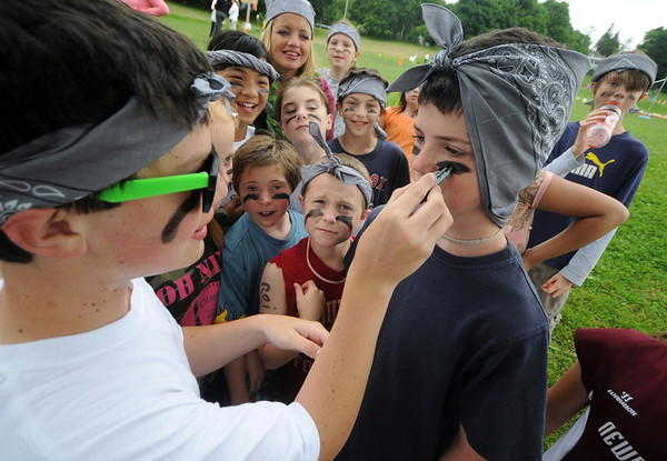 Newburyport: Liam O'Connell puts eye black on Blake Flaherty during Survival Day at the Molin School Thursday. 4th and 5th graders emulated the TV show Survivor with 14 events testing the students skills and resolve. Jim Vaiknoras/staff photo
