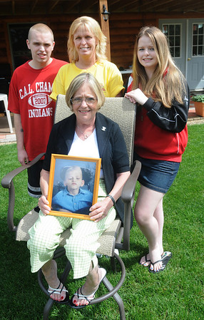 Amesbury:Jean Panza holds a photo of Drew Doucet whose heart she recieved after his death. behing her are Drew's mother,Paula Flint, his brother,Jared Spurr and his sister,Hayley Flint. Jim vaiknoras/staff photo