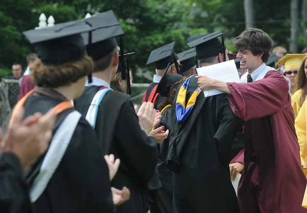 Newburyport: Newburyport high senior class president Nicholas Osborne hugs one of his teacher after the graduation ceremony Sunday afternoon at World War Memorial Stadium.Jim Vaiknoras/staff photo