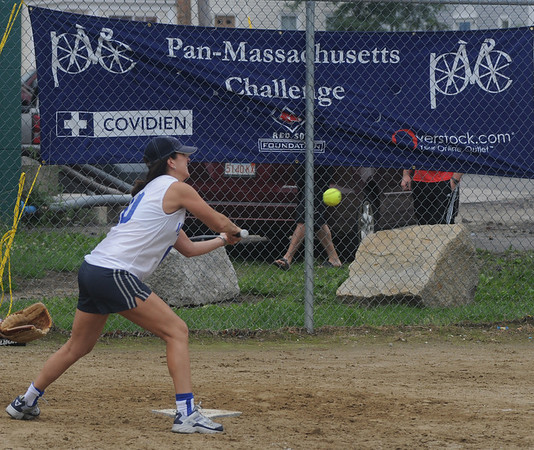 Newburyport: Beth Connolly of Amesbury get a hit during the Pan-Mass Challenge softball tournament Saturday at Cashman Park. Jim Vaik noras/Staff photo