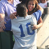 Lowell: Georgetown's Mario Luisi gets a hug from his mom Roseanne after the Royal's 4-3 victory over Newburyport Saturday at Lelacheur Park in Lowell. Jim Vaiknoras/staff photo