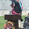 Newburyport: Newburyport  senior Collin Cusack lifts up Principal Michael Parent during the graduation ceremony Sunday afternoon at World War Memorial Stadium.Jim Vaiknoras/staff photo