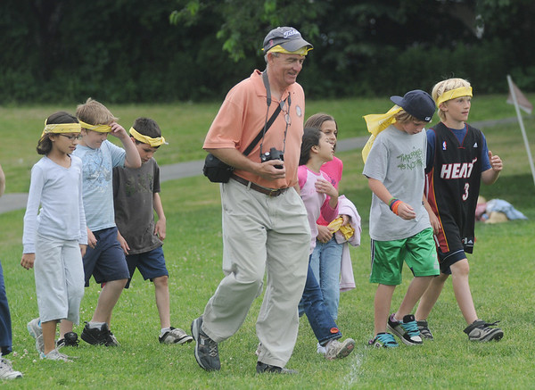 Newburyport: Retiring teacher Neil Reardon walks with his students Friday during Survivor Day at the Molin School. Jim Vaiknoras/Staff photo