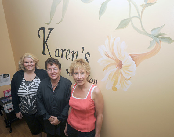 Merrimac:karen grey , center with her co-workers, Marie Corey, right and Shannon Bennett at Karen 's Nail and Hair Salon in Merrimac. Jim Vaiknoras/Staff photo