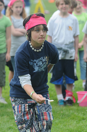 Newburyport:Izzy Sarra deoes her best to keep from spilling her spoon full of rice during a relay race at Survival Day at the Molin School Thursday. 4th and 5th graders emulated the TV show Survivor with 14 events testing the students skills and resolve. Jim Vaiknoras/staff photo