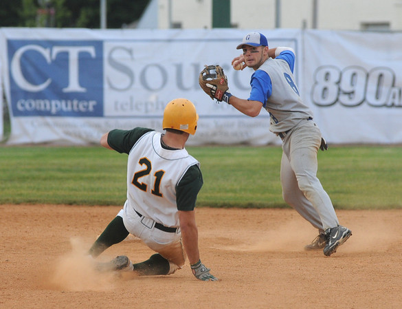 Lynn: Georgetown's Anthony Conte turns a double play as North Reading's Kevin Singer slides into 2nd during the Royal's 2-1 victory at Fraser Field in Lynn. Jim Vaiknoras/staff photo