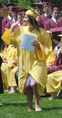 Newburyport: Newburyport  senior Katelyn Chaisson gives a wave to the crowd after getting her diploma during the graduation ceremony Sunday afternoon at World War Memorial Stadium.Jim Vaiknoras/staff photo
