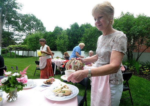 Amesbury: Dorothy Fairweather pours a cup of tea at the Whittier home  in Amesbury for Tea in the Garden  Saturday morning. This was the first on four teas this summer, the other are July 16, August 12, and September 9.Jim Vaiknoras/Staff photo