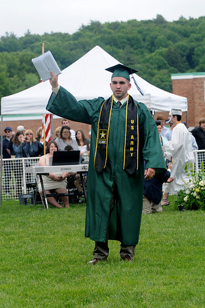West Newbury: Justin O'Donnell wave to his family after getting his diploma at the Pentucket Graduation Saturday morning.Jim Vaiknoras/staff photo