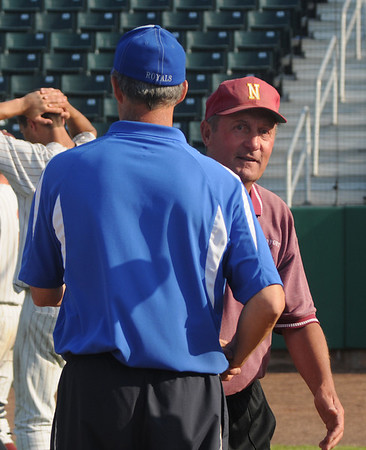 Lowell: Georgetown'coach Mike Rowe shakes hand with Newburyport coach Bill Pettingell after the Royal's 4-3 victory over Newburyport Saturday at Lelacheur Park in Lowell. Jim Vaiknoras/staff photo