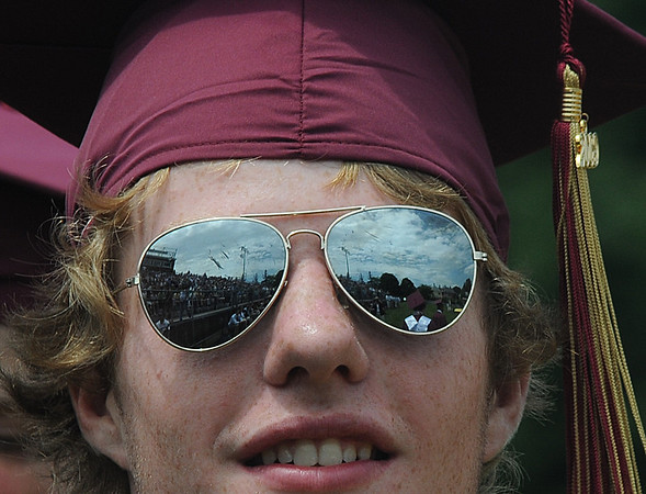 Newburyport: Newburyport senior Samual Toolan reflects the day in his glasses during the graduation ceremony Sunday afternoon at World War Memorial Stadium.Jim Vaiknoras/staff photo