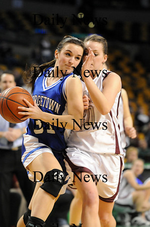 Boston: Georgetown's Kelly Gillen (31) is fouled by a Millis player on her way to the hoop during Monday's state championship game. Photo by Ben Laing/Newburyport Daily News Monday March 9, 2009.