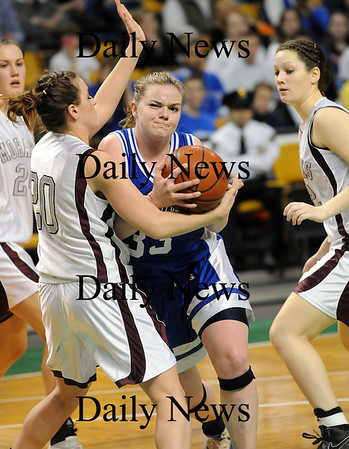 Boston: Taryn O'Connell (33) of Georgetown his fouled as she tries to get to the hoop during Monday's state championship game against Millis. Photo by Ben Laing/Newburyport Daily News Monday March 9, 2009.