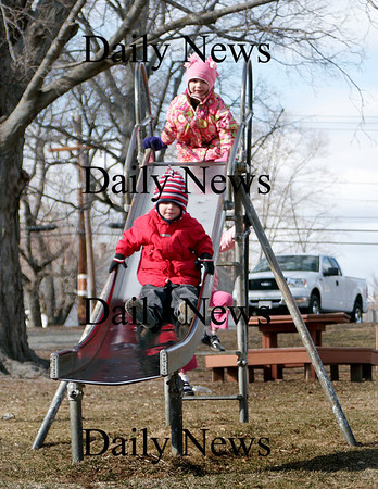 Amesbury: Carter Leonard, 3, goes down the slide at the Amesbury Town Park, as his sister, Chloe, waits at the top. Photo by Ben Laing/Staff Photo