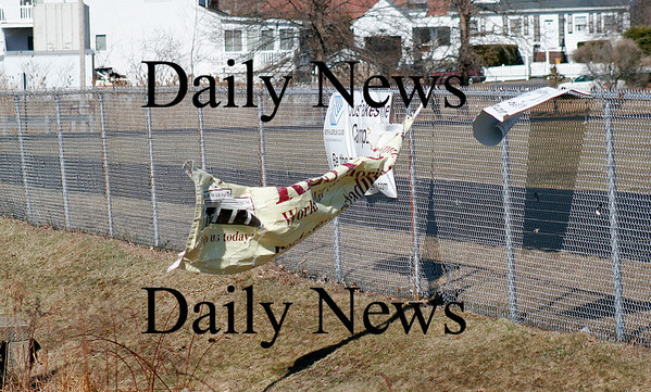Newburyport: Strong winds wreak havoc on this sign at the Fuller Field on Low Street in Newburyport Monday morning.  Photo by Ben Laing/Staff Photo