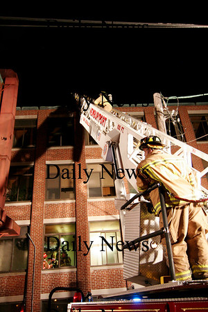 Newburyport: Firefighter investigate the Saturday night fire at Glenns in Newburyport.Ben Laing/Staff photo