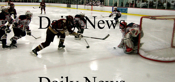 Chelmsford: Derek Freeman takes a shot on Lincoln-Sudbury's goalie midway through the second period of Thursday nights game. Photo by Ben Laing/Newburyport Daily News Thursday March 5, 2009.