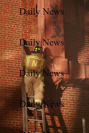 Newburyport: a Newburyport firefighter investigates a fire at Glenns Saturday night. Ben Laing/Staff Photo