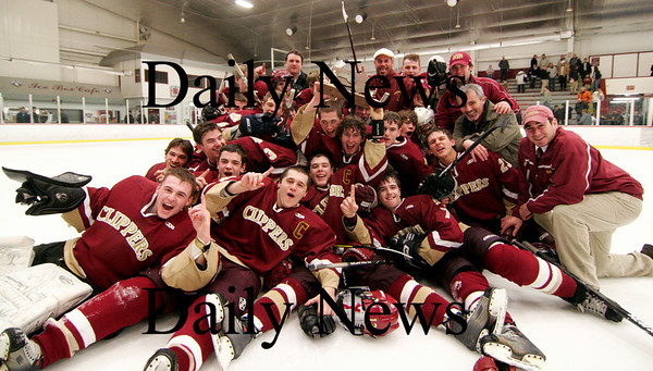 Chelmsford: The Newburyport hockey team celebrates on the ice with their North Sectional trophy after they defeated Lincoln-Sudbury 3-1 in Chelsford. The Clippers advance to the Eastern Mass. Finals at the TD Banknorth Garden on Saturday night. Photo by Ben Laing/Newburyport Daily News Thursday March 5, 2009.