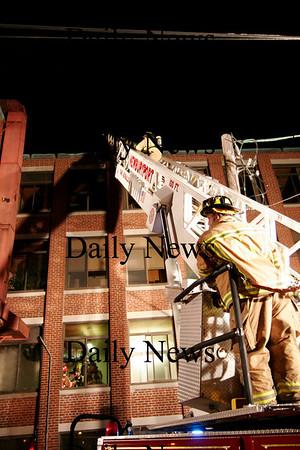 Newburyport: Firefighter investigate the Saturday night fire at Glenns in Newburyport.Ben Laing/Staff photo