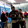 Stoneham: Newburyports captains, Kevin Holmes and Colin Cusack celebrate on their way to the locker room after defeating Tewksbury 7-4 and advancing to the North Sectional Final on Thursday. Photo by Ben Laing/Newburyport Daily News Tuesday March 3, 2009.