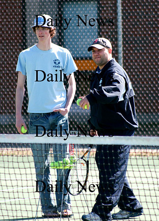 Byfield: Triton's new tennis coach, Chad Richard, instructs one of his players during the team's practice Tuesday afternoon. Photo by Ben Laing/Staff Photo