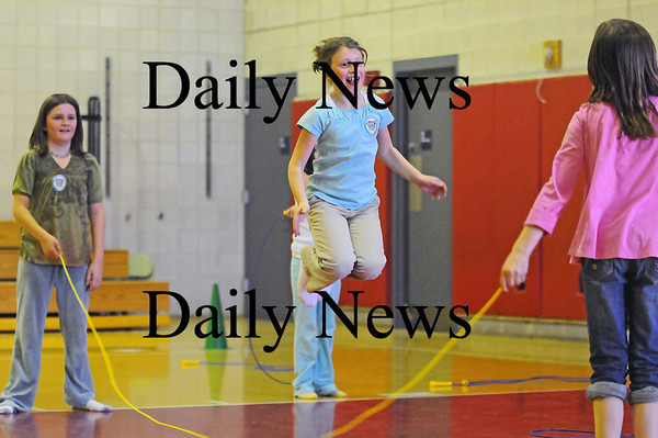 Amesbury: Madeline Gravelle jumps rope as  Michaela Halloran, left, and Emma Vandenberg, right, twirl it around during gym class at Cashman Elementary. These third graders were participating in the Jump Rope for Heart program. Photo by Ben Laing/Newburyport Daily News Thursday March 5, 2009.