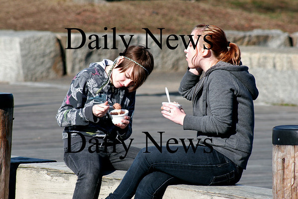 Newburyport: Dara Niketic, left, and Autumn Dingwell, both 16, enjoy the first nice day of spring with ice cream along the boardwalk in Newburyport. Photo by Ben Laing/Staff Photo