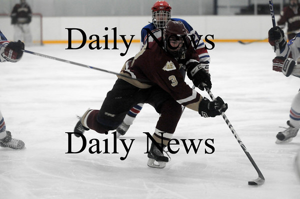 Stoneham: Kyle McElroy breaks in on the Tewksbury goalie during Newburyport's game Tuesday night in Stoneham. Photo by Ben Laing/Newburyport Daily News Tuesday March 3, 2009.
