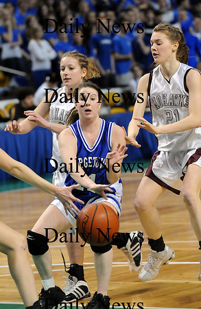 Boston: Shannon Hartford (11) of Georgetown dishes the ball during Monday's state championship game against Millis. Photo by Ben Laing/Newburyport Daily News Monday March 9, 2009.