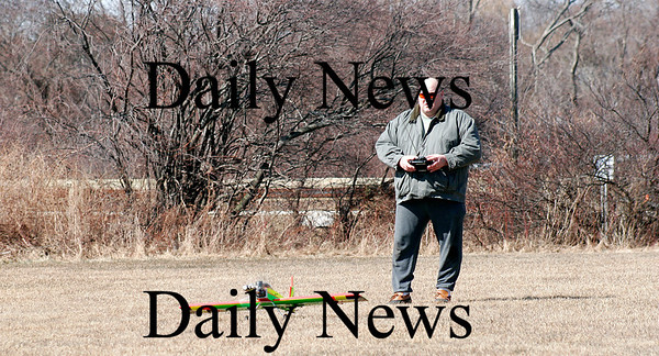Newbury: Chris Dodge of Plum Island flies his model airplane at the Plum Island airport on Friday afternoon. Photo by Ben Laing/Staff Photo