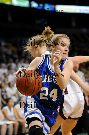 Boston: Pauline Reilly (24) of Georgetown moves past a Millis defender during Monday's Division 4 state championship game in Boston. Photo by Ben Laing/Newburyport Daily News Monday March 9, 2009.