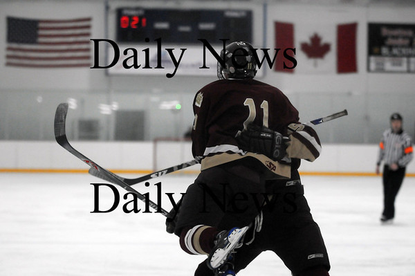 Stoneham: Newburyport's Ryan Cutter (11) leaps into the arms of a teammate after scoring a goal in the second period of Tuesday nights game against Tewksbury. Photo by Ben Laing/Newburyport Daily News Tuesday March 3, 2009.