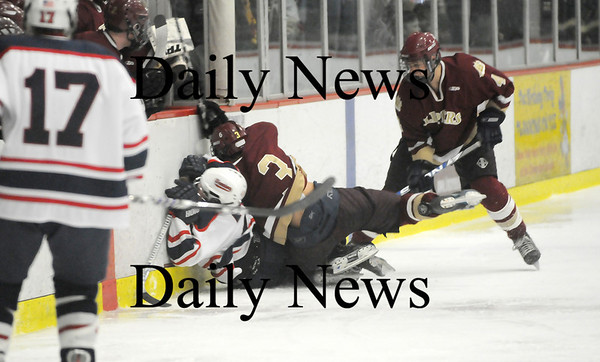 Chelmsford: Kyle McElroy (3) lays a big hit on a Lincoln-Sudbury player during Newburyport's 3-1 win on Thursday night. The Clippers will play Canton at the TD Banknorth Garden on Saturday night. Photo by Ben Laing/Newburyport Daily News Thursday March 5, 2009.
