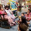 Newburyport: Emma Cutter shows Mrs. LeBay's first grade class a picture in her Dr. Suess story book, as she and Peyton Holley share a story with the class at the Bresnahan Elementary School Tuesday. Mrs. LeBay's class has read or listened to over 500 books this month as part of the Read Across America progam. Photo by Ben Laing/Staff Photo