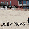 Newbury: A local beachcomber searches the sands near Plum Island Center Tuesday afternoon. Photo by Ben Laing/Staff Photo