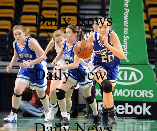 Georgetown: Three of Georgetown's seniors, Taryn O'Connell, left, Shannon Hartford, center, and Haley Gisonno, right, were in seventh grade the last time the Royals went to the state final game at the TD Banknorth Garden. Photo by Ben Laing/Newburyport Daily News Monday March 9, 2009.
